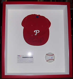 framed Chase Utley signed baseball & cap at Station Gallery